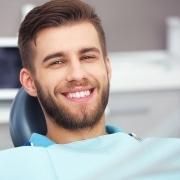 Man in dental chair smiling